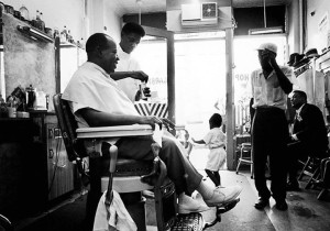 Louis Armstrong gets a haircut in his local barbershop in Queens, New York, circa 1965 (LIFE Magazine)